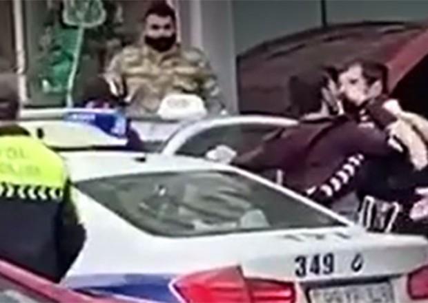 DİN-dən polislə mübahisə edən sürücü ilə bağlı AÇIQLAMA (VİDEO)